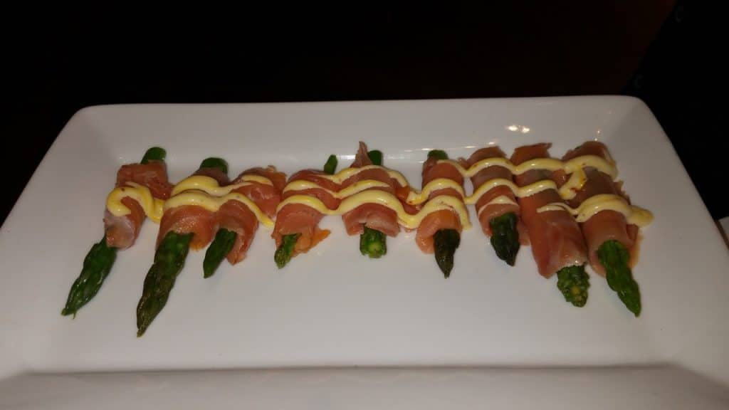 House smoked salmon wrapped around asparagus tips tarragon sauce 1024x576 - Butlered Hors d'oeuvres