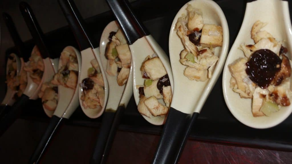 Smoked chicken with dried cherries and walnut oil on Asian spoons 1024x576 - Butlered Hors d'oeuvres